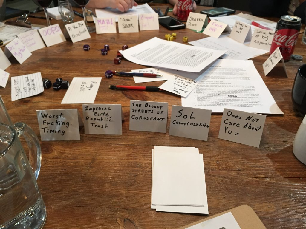 Photograph of tented index cards showing the character aspects discussed in the body of the article.