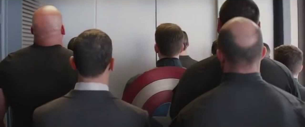 Back of heads in an elevator.  Precursor moment to an amazing fight scene in Captain America: The Winter Soldier